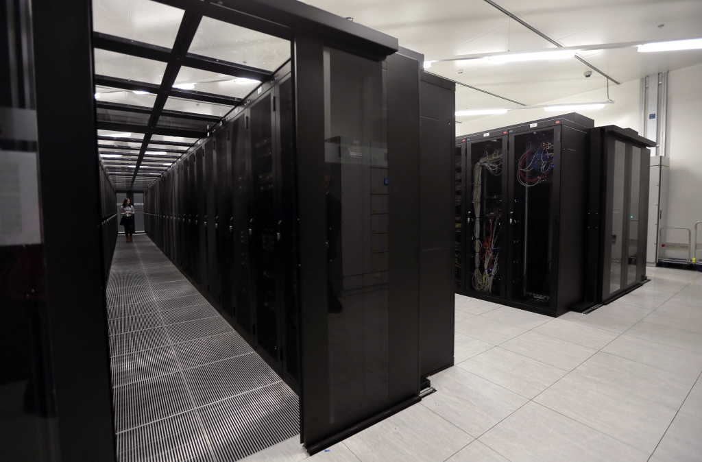 A picture taken on September 17, 2013 in Saint-Denis, outside Paris, shows a room of cabling servers