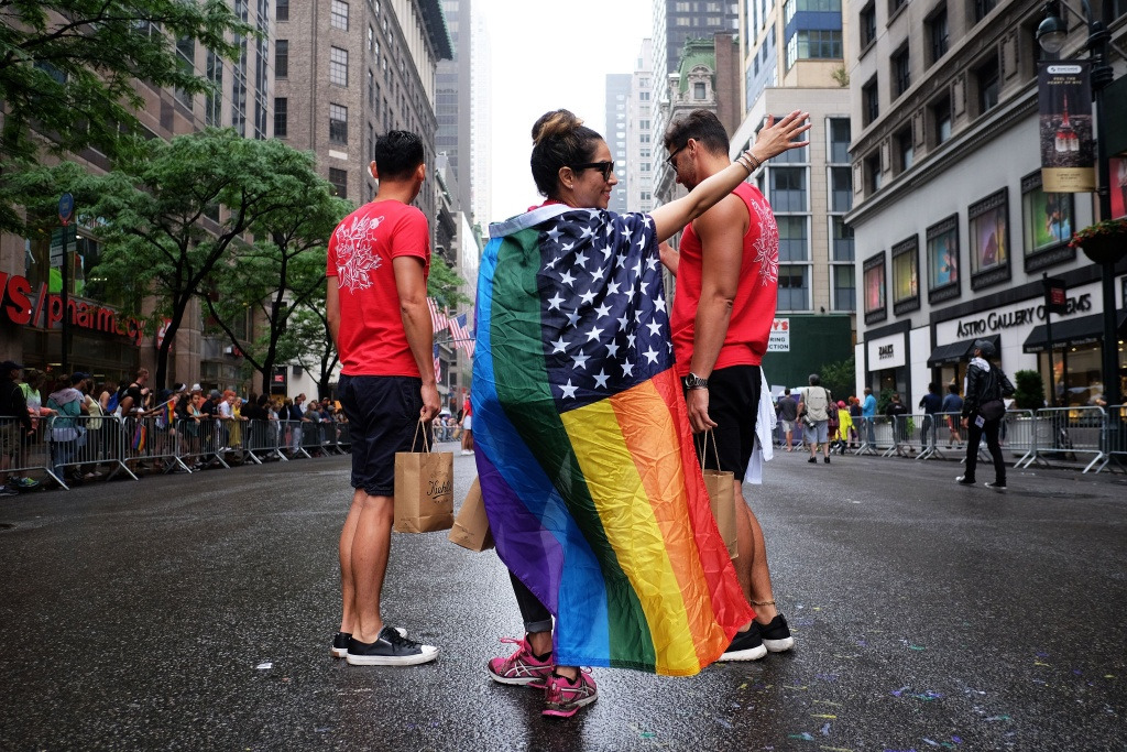 Participants wait for the start of the 2015 New York City Pride march in New York on June 28, 2015. Under a sea of rainbow flags, hundreds of thousands of jubilant supporters poured onto New York's streets for the annual Gay Pride March, two days after the US Supreme Court's landmark ruling to legalize gay marriage.