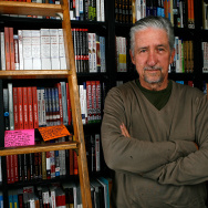 "Author Tom Hayden poses before signing copies of his book, ""Ending The War in Iraq"" at Book Soup June 24, 2007 in Los Angeles, California."