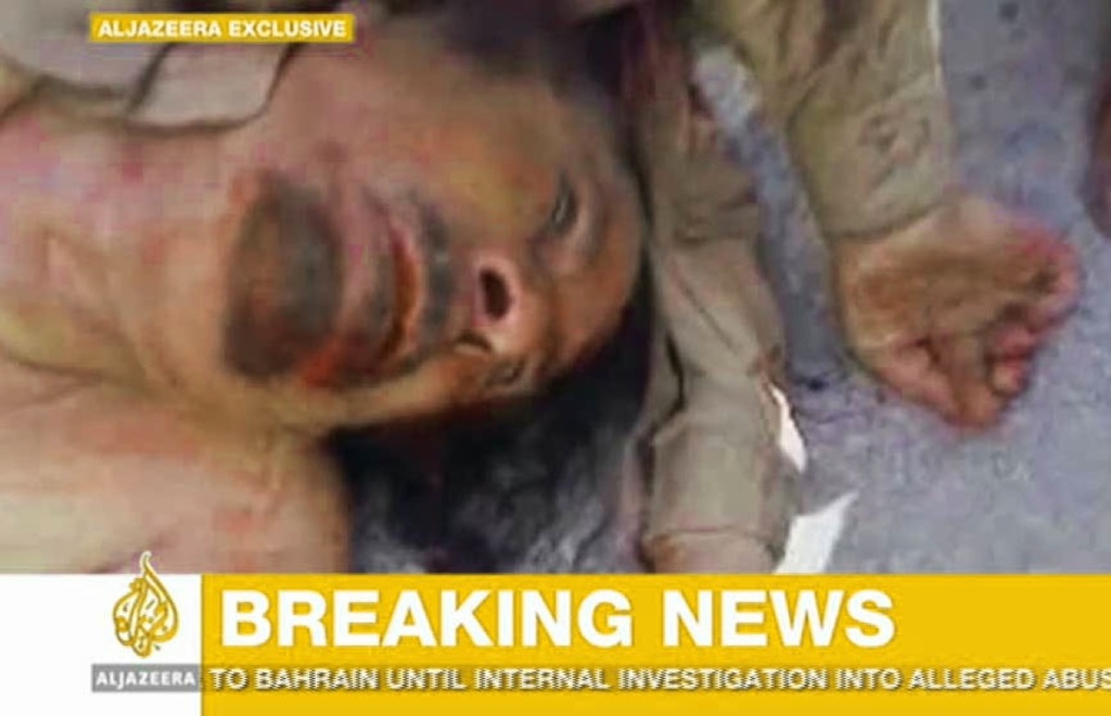 This image made available by the Al Jazeera television channel, claims to show former Libyan leader Moammar Gadhafi, after he was killed at an undisclosed location in Libya, Thursday Oct. 20, 2011.