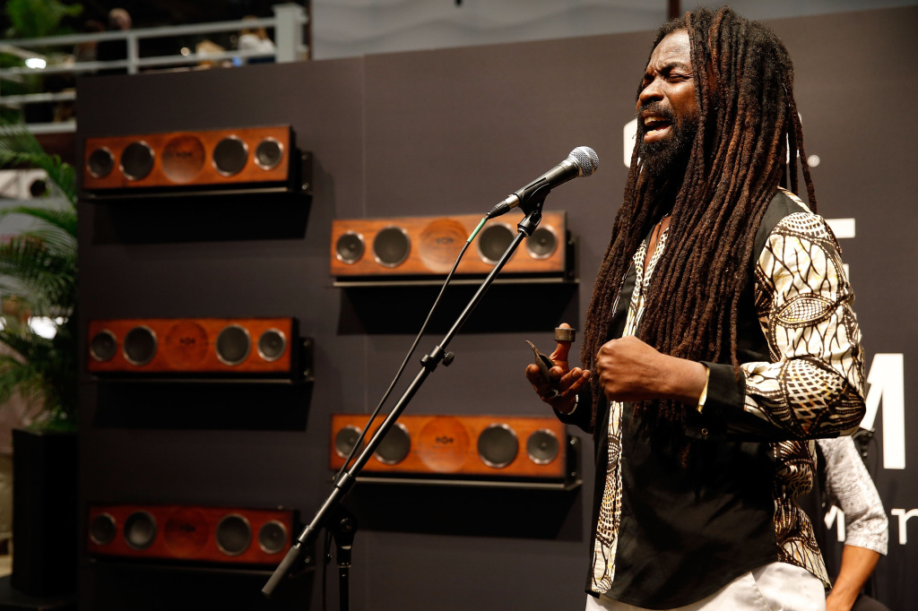 Rocky Dawuni performs at the House of Marley booth during CES 2016 on January 7, 2016 in Las Vegas, Nevada.