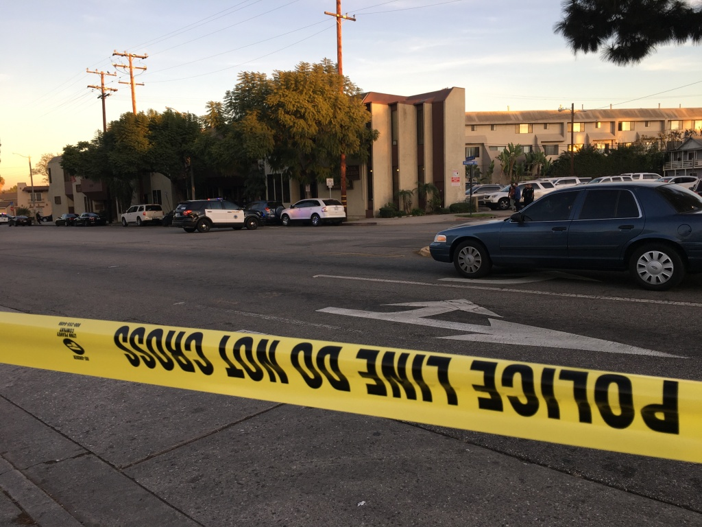 Police say a shooting at a business in Long Beach has left at least two people dead, including the gunman.