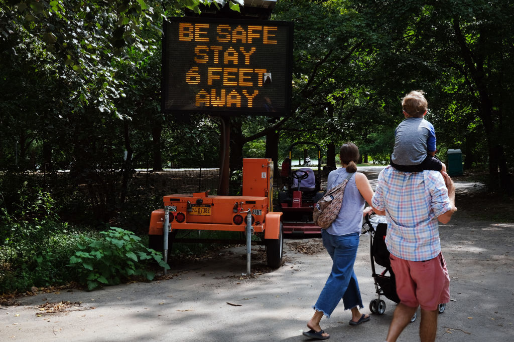 A sign at a public park instructs people to keep their distance due to COVID-19 on September 14, 2020 in the Brooklyn borough of New York City.