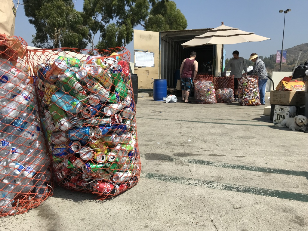 Customers sort bottles and cans at a recycling center in Eagle Rock, Aug. 8, 2019. (David Wagner/KPCC)