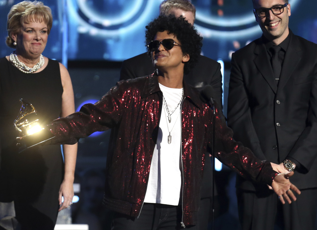Bruno Mars accepts the award for record of the year for