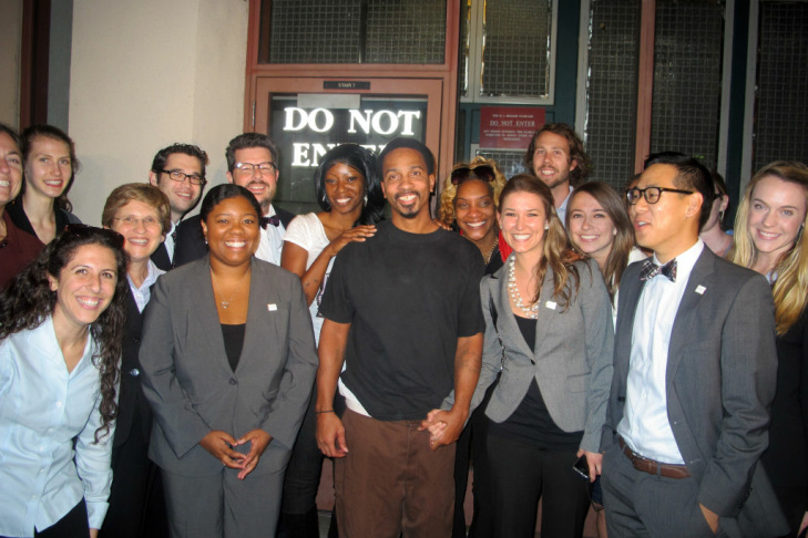 Obie Anthony is surrounded by the Loyola students who helped him on his case, plus his wife (left) and sister (right).