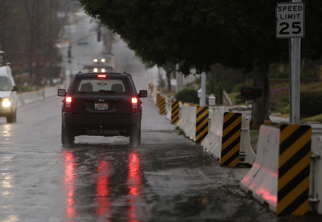 Concrete barriers are set against flood debris in Glendora on Tuesday, Jan. 5, 2016.
