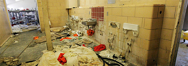 Lavatory and dormitory facilities lay in ruins during a tour of the California Institution for Men in Chino, Calif., Tuesday, Aug. 11, 2009. Blood-soaked mattresses, singed bedding and abandoned backboards and medical supplies littered the campus of the Chino prison, a testament to the violence of the riot that shut down part of the institution and injured nearly 200 inmates.