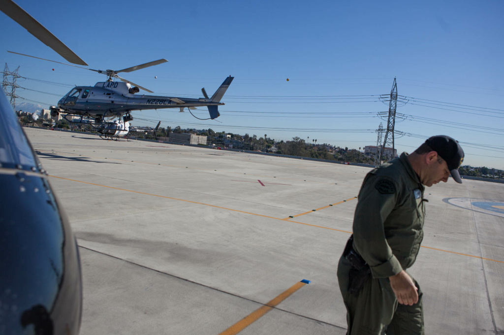 LAPD helicopter pilot Kevin Cook exits the helipad after a three-hour shift in the skies above Los Angeles.