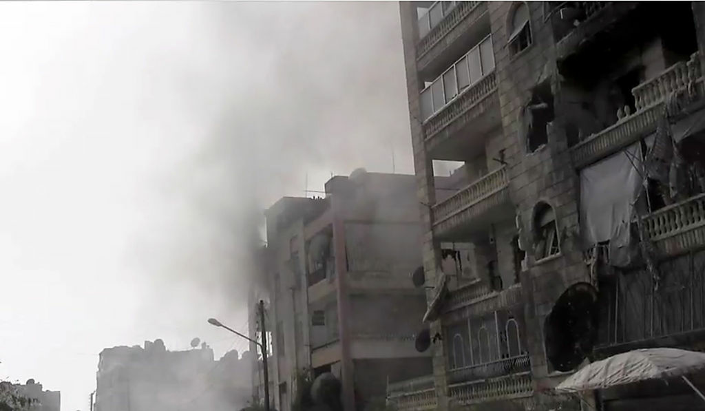 An image grab taken from one of James Foley's videos for AFP TV shows heavily damaged buildings during clashes between Syrian rebels and regime forces in the Amariyeh district of the northern city of Aleppo on August 31, 2012. Foley's parents says they've received no word on the whereabouts of their son for over a month.