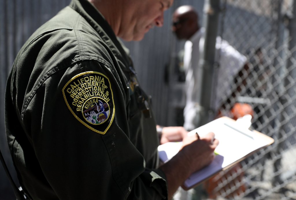 A California Department of Corrections and Rehabilitation (CDCR) officers log condemned inmates who are leaving the exercise yard at San Quentin State Prison's death row on August 15, 2016 in San Quentin, California.
