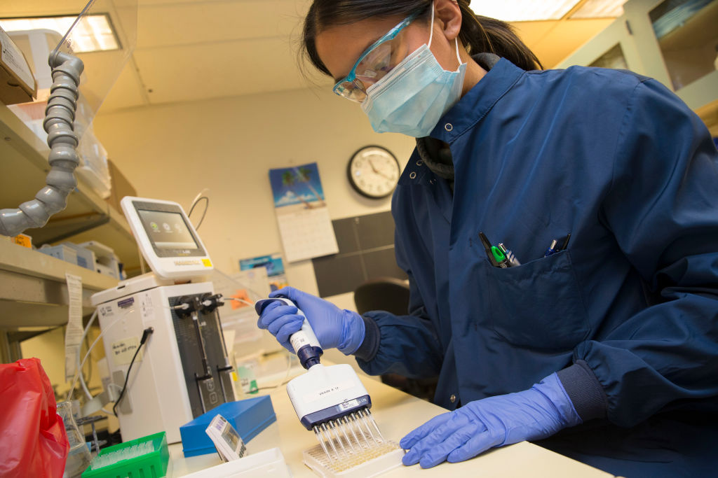 SEATTLE, WA - APRIL 17: Medical laboratory scientist, Alicia Bui, runs a clinical test in the Immunology lab at UW Medicine looking for antibodies against SARS-CoV-2, a virus strain that causes coronavirus disease (COVID-19) on April 17, 2020 in Seattle, Washington. The plasma she is examining came from donors who have recovered from COVID-19, a contagious respiratory illness, and may have the potential to help combat the disease in others. (Photo by Karen Ducey/Getty Images)