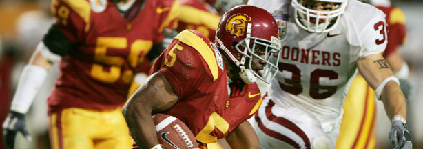 File: Running back Reggie Bush #5 of the USC Trojans carries the football against the Oklahoma Sooners defense in the second quarter during the FedEx Orange Bowl 2005 National Championship on January 4, 2005 at Pro Player Stadium in Miami, Florida.