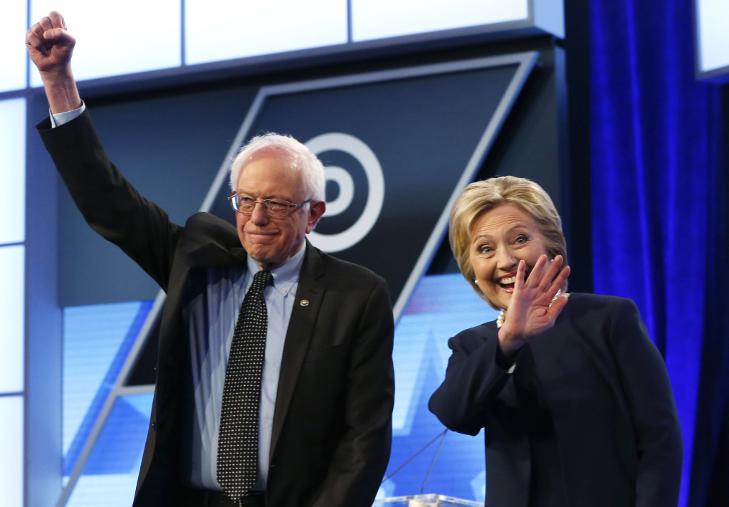 Democratic presidential candidates Sen. Bernie Sanders and Hillary Clinton stand together before the start of the Univision-<em>Washington Post</em> debate at Miami Dade College in Miami on Wednesday.