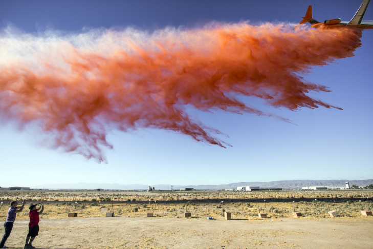 The U.S. Forest Service conducts a fire retardant drop test for a new air tanker at Fox Airfield in Lancaster on Friday, July 8, 2016.