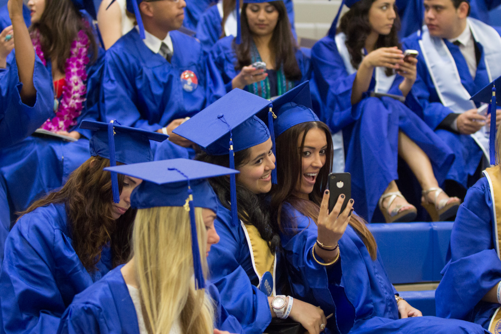 Students take photos at the Santa Monica College graduation on June 11th, 2013.