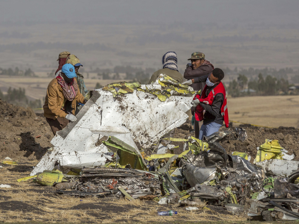 Rescuers work at the scene of an Ethiopian Airlines Boeing 737 Max that crashed near Bishoftu, or Debre Zeit, south of Addis Ababa, Ethiopia, in March 2019.