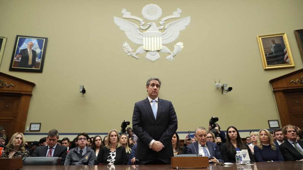 Michael Cohen prepares to testify before the House oversight committee on Capitol Hill Wednesday in Washington, D.C.