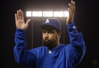 Pitcher Jose Lima #27 of the Los Angeles Dodgers waves to the crowd as he walks off the field after the National League Division Series Game Four loss 6-2 to St. Louis Cardinals on October 10, 2004 at Dodger Stadium.