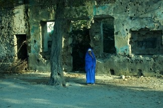 A Somali girl in Mogadishu. The city was once a beautiful, seaside tourist town, but two decades of civil war has left it in ruins.