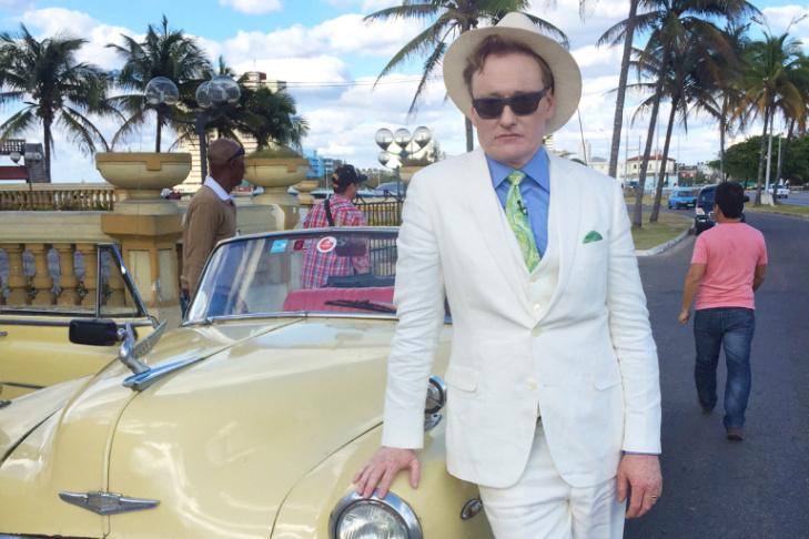 Conan O'Brien stars in his own parade through the streets of Havana.