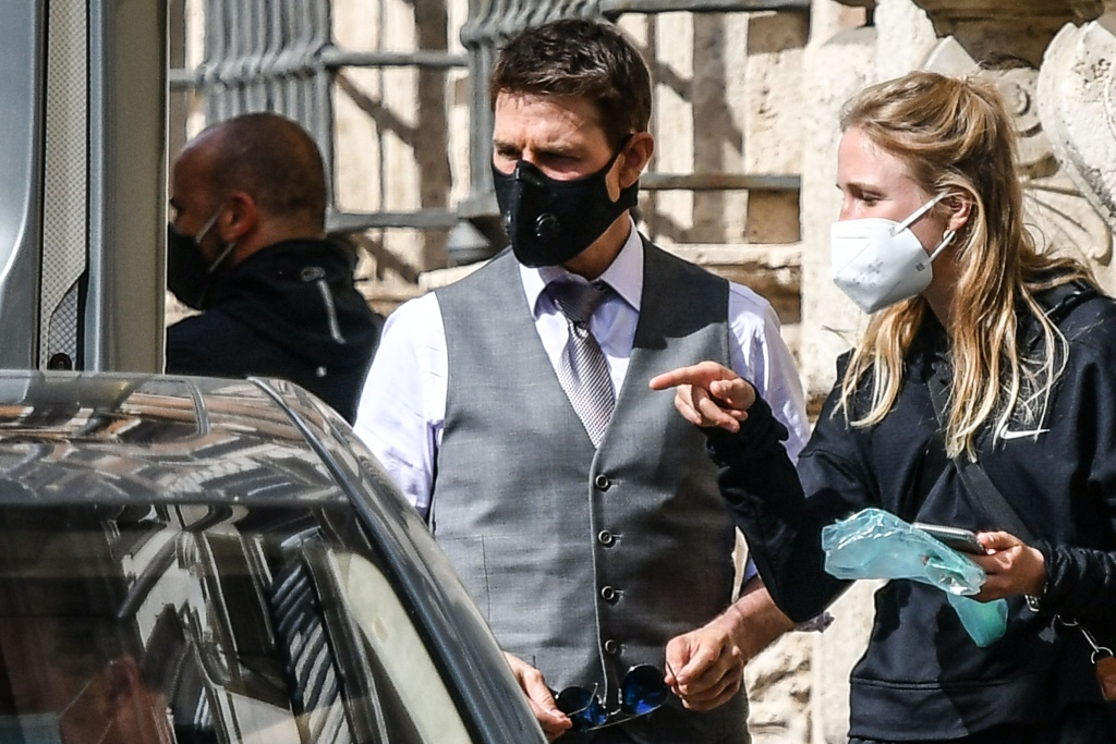 US actor Tom Cruise (C), wearing a face mask, is pictured on the set during the filming of