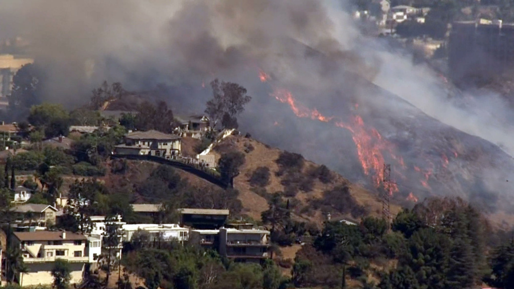 A brush fire burning near the 101 Freeway on Tuesday, July 19, 2016.