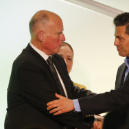 California Gov. Jerry Brown, left, greets Mexico's President Enrique Pena Nieto during a meeting with Mexican-American community leaders and others in Los Angeles, Monday, Aug. 25, 2014. (AP Photo/Damian Dovarganes)
