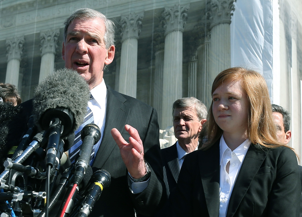 Attorney Bert Rein (L), speaks to the media while standing with plaintiff Abigail Noel Fisher (R), after the U.S. Supreme Court Supreme heard arguments in her caseon October 10, 2012 in Washington, DC. The high court heard oral arguments on Fisher V. University of Texas at Austin and are tasked with ruling on whether the university's consideration of race in admissions is constitutional.