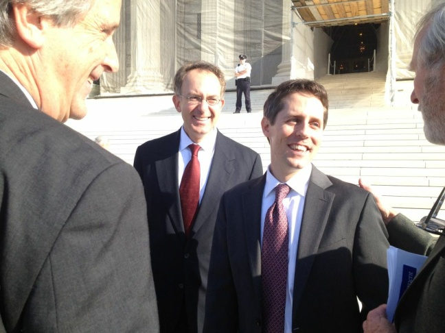 Attorney Aaron Colangelo is congratulated by colleagues from the Natural Resources Defense Council after arguing case before the U.S. Supreme Court