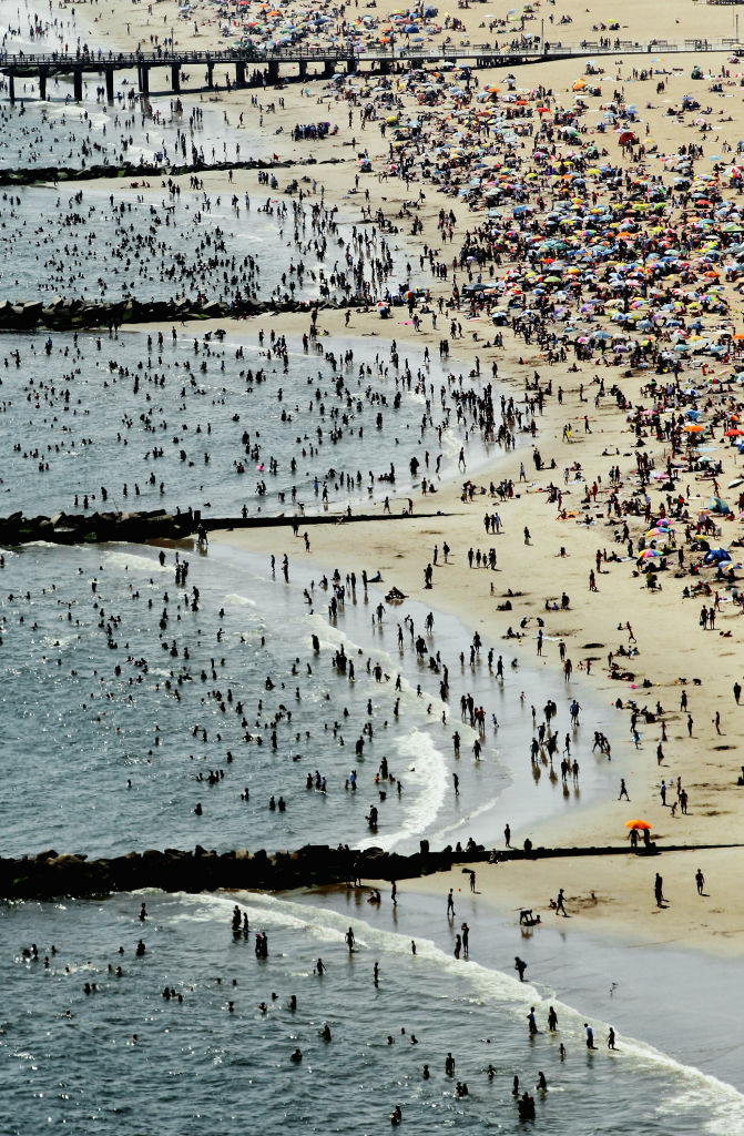 An aerial view of New Yorkers taking in the sun on a beach at Coney Island on August 4, 2012 in the Brooklyn borough of New York City. The past year through June 2012 in the continental United States has been the hottest since modern record-keeping started in 1895, according to the National Oceanic and Atmospheric Administration (NOAA). NOAA also reports the ten warmest years since 1895 have occurred since 2000.