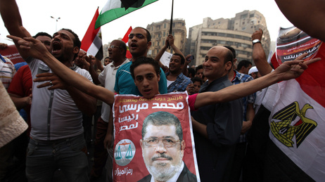 Supporters of Muslim Brotherhood candidate Mohammed Mursi (in portrait) celebrated June 18, 2012 in Cairo's Tahrir Square.