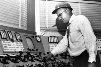 In this little seen photo, Theodore Filson, an engineer at the LA County Heatwave Generator cranks up the temperature in the LA Basin. Don't blame him, though. He gets his orders from the nation's air conditioner manufacturers, which operate state-of-the-art centers like these throughout the country.