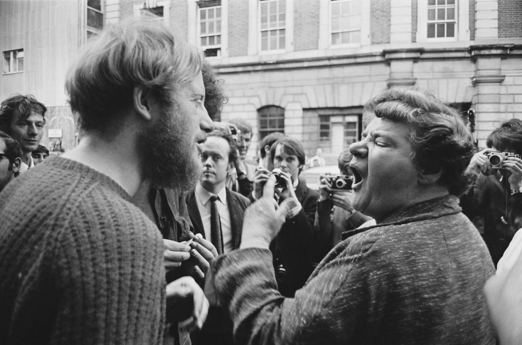 A local woman argues with one of the squatters occupying a building on Endell Street, London, 1969.