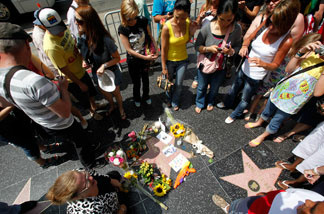 Fans pay their respects at the star of Michael Jackson on the Hollywood Walk of Fame on the first anniversary of the pop star's death Friday, June 25, 2010.