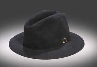 "Michael Jackson's Victory Tour black fedora with an interior, black leather hat band stamped ""By Maddest Hatter … Made expressly for Michael Jackson … 100 percent genuine fur."" The hat was caught by an audience member attending the July 31, 1984 Jackson concert at Giants Stadium in East Rutherford, N.J."