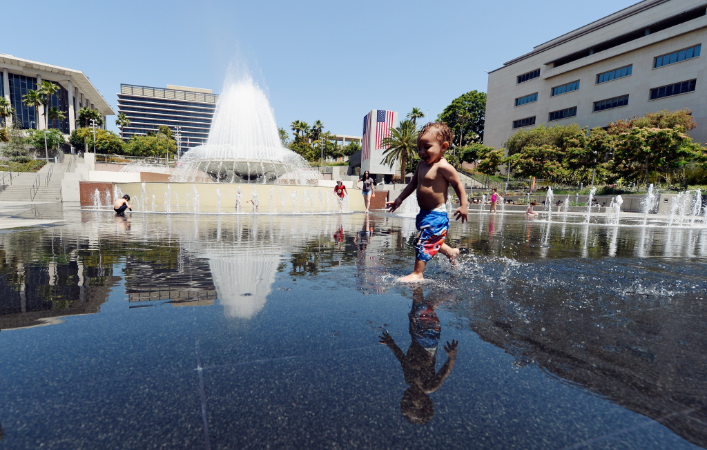 Ali Zenaidi, 2, cools off in the Arthur J. Will Memorial Fountain inside Grand Park during a major heat wave in Southern California on June 28, 2013 in downtown Los Angeles, California. Temperatures are expected to be in the triple digits in most areas of Southern California. According to the national Weather Service, the heat wave is expected to linger into early next week prompting heat advisories and opening of cooling centers.