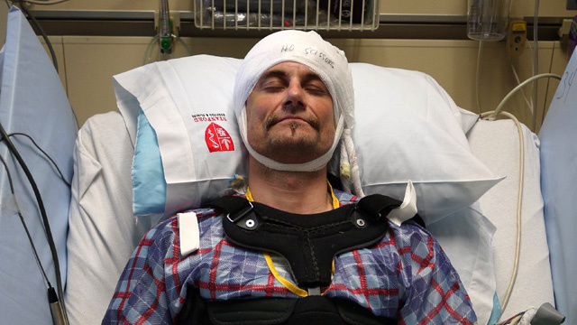 Nate Bennett relaxes in his hospital bed, waiting to detect changes as tiny jolts of electricity enter his brain.