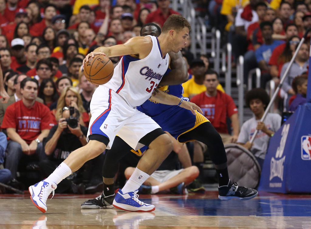Blake Griffin #32 of the Los Angeles Clippers drives against Draymond Green 323 of the Golden State Warriors in Game Seven of the Western Conference Quarterfinals during the 2014 NBA Playoffs at Staples Center on May 3, 2014, in Los Angeles.