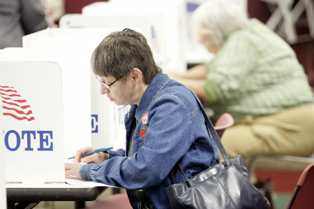 A woman casts her ballot during early voting October 1, 2008 in Toledo, Ohio.