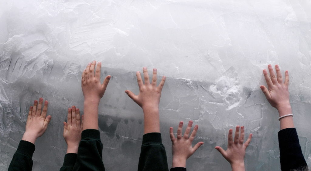 Children place their hands on a life size ice carving of a polar bear by animal sculptor Mark Coreth in Trafalgar Square, central London, on December 11, 2009. The sculpture was part of a campaign by the World Wildlife Fund (WWF) to highlight the plight of the polar bears in the Arctic, where melting ice is threatening their survival. EU nations are set to give more than six billion euros (nine billion dollars) to help the developing world tackle climate change in the next three years, British Prime Minister Gordon Brown said Friday.