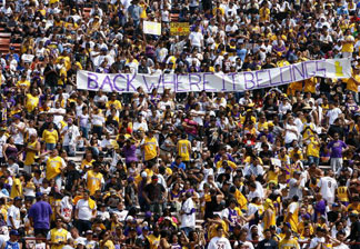 Fans of the Los Angeles Lakers cheer during the 2009 NBA Championship Victory Parade and Rally at the Los Angeles Memorial Coliseum on June 17, 2009 in Los Angeles, California. This year's parade is expected to bring tens of thousands downtown.