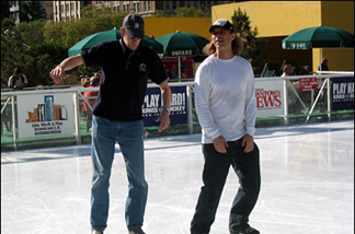 John Rabe (L) on the ice at Pershing Square with Clark Tufts, a former pro IHL player who manages the rink and coaches hockey.