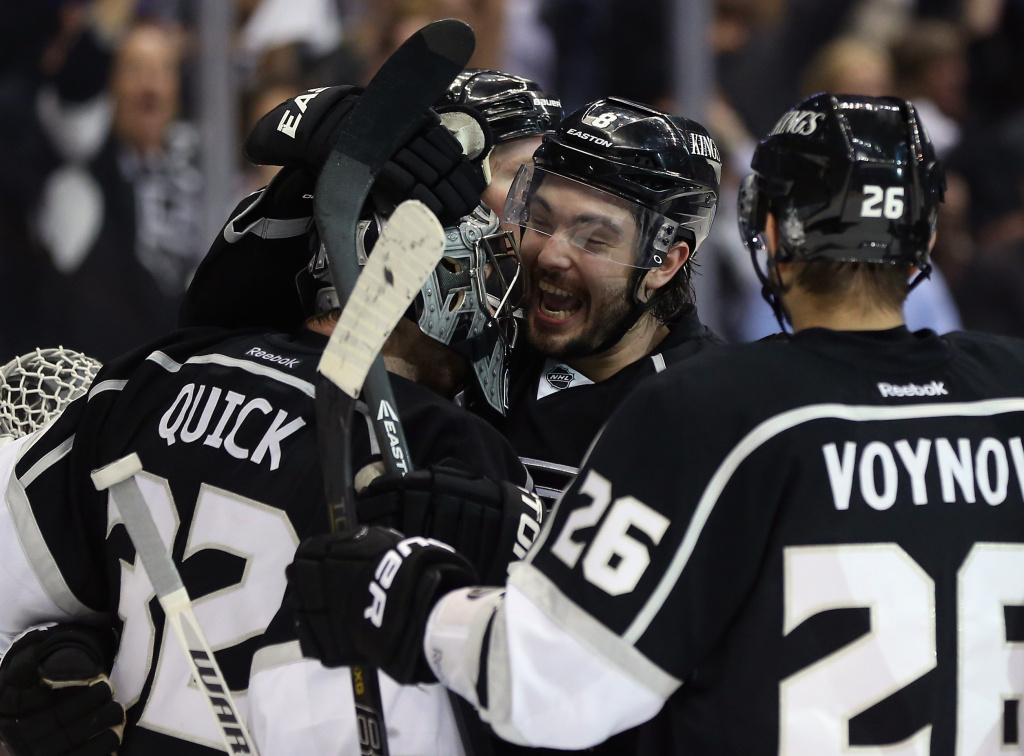 (L-R) Goaltender Jonathan Quick #32, Drew Doughty #8 and Slava Voynov #26 of the Los Angeles Kings celebrate their teams 2-1 victory over the San Jose Sharks in game Seven of the Western Conference Semifinals during the 2013 NHL Stanley Cup Playoffs at Staples Center on May 28, 2013 in Los Angeles.