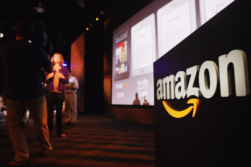 Members of the media cover the launch of the new Amazon tablet called the Kindle Fire on September 28, 2011 in New York City.