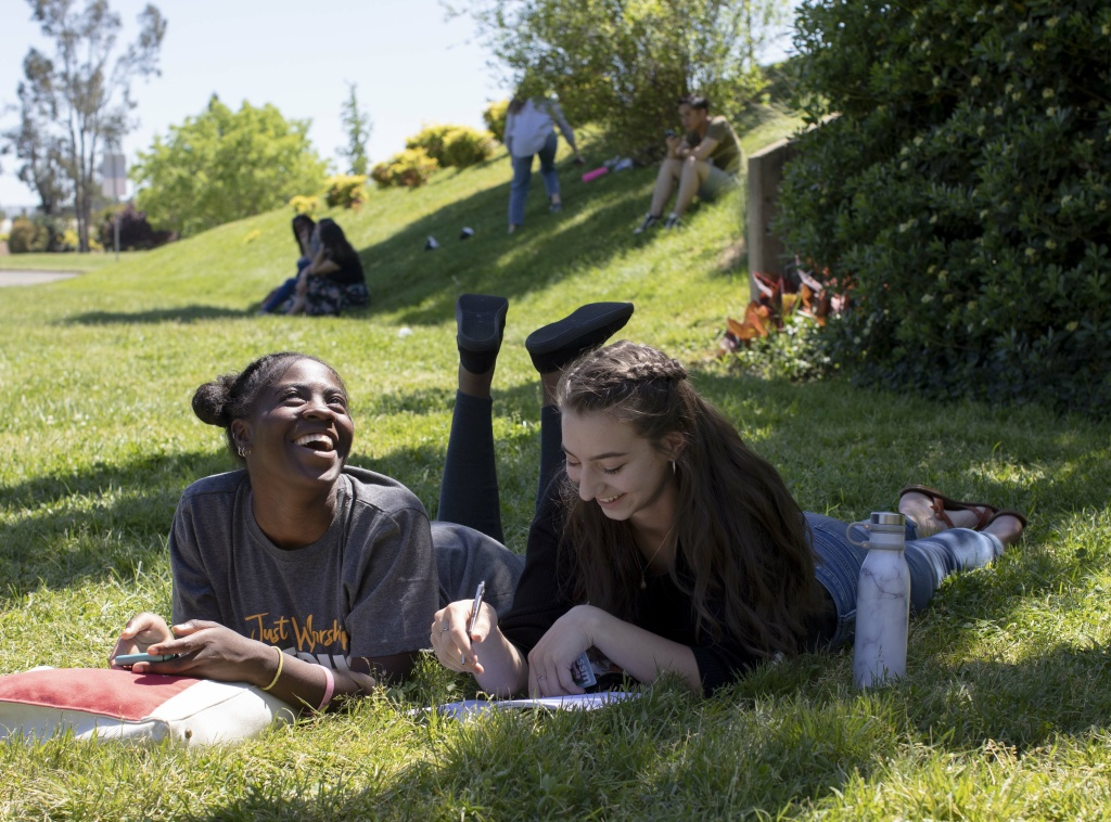 BSSM students talk and do homework between classes outside of the Redding Civic Auditorium, which a Bethel-connected nonprofit manages for the City, on April 29th, 2019.
