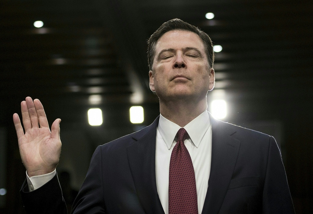 Former FBI director James Comey is sworn in during a hearing before the Senate Select Committee on Intelligence on Capitol Hill June 8, 2017 in Washington, DC.