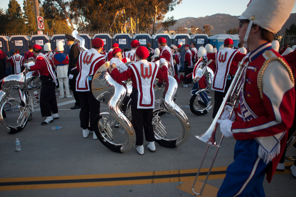 Members of the Wisconsin marching band take a pit stop before setting off on their six-mile trek down Colorado Boulevard for Pasadena's Rose Parade.