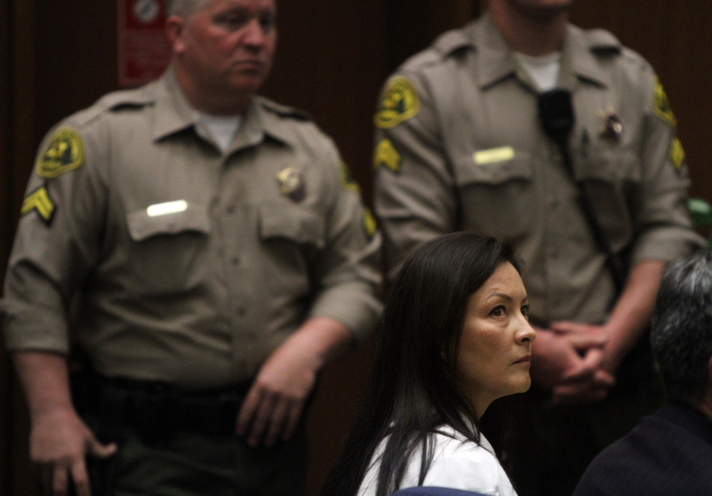 File: Kelly Soo Park listens to her attorney George Buehler make opening statements in Los Angeles.