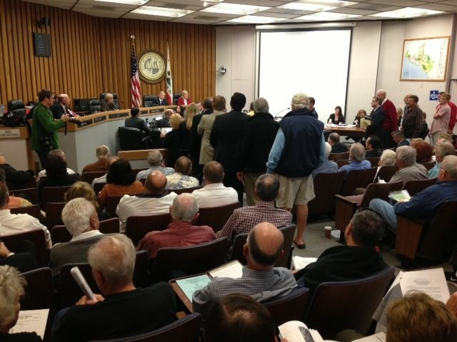 Dock owners crowded Newport Beach's old city hall, but the dock fee passed 5-1.
